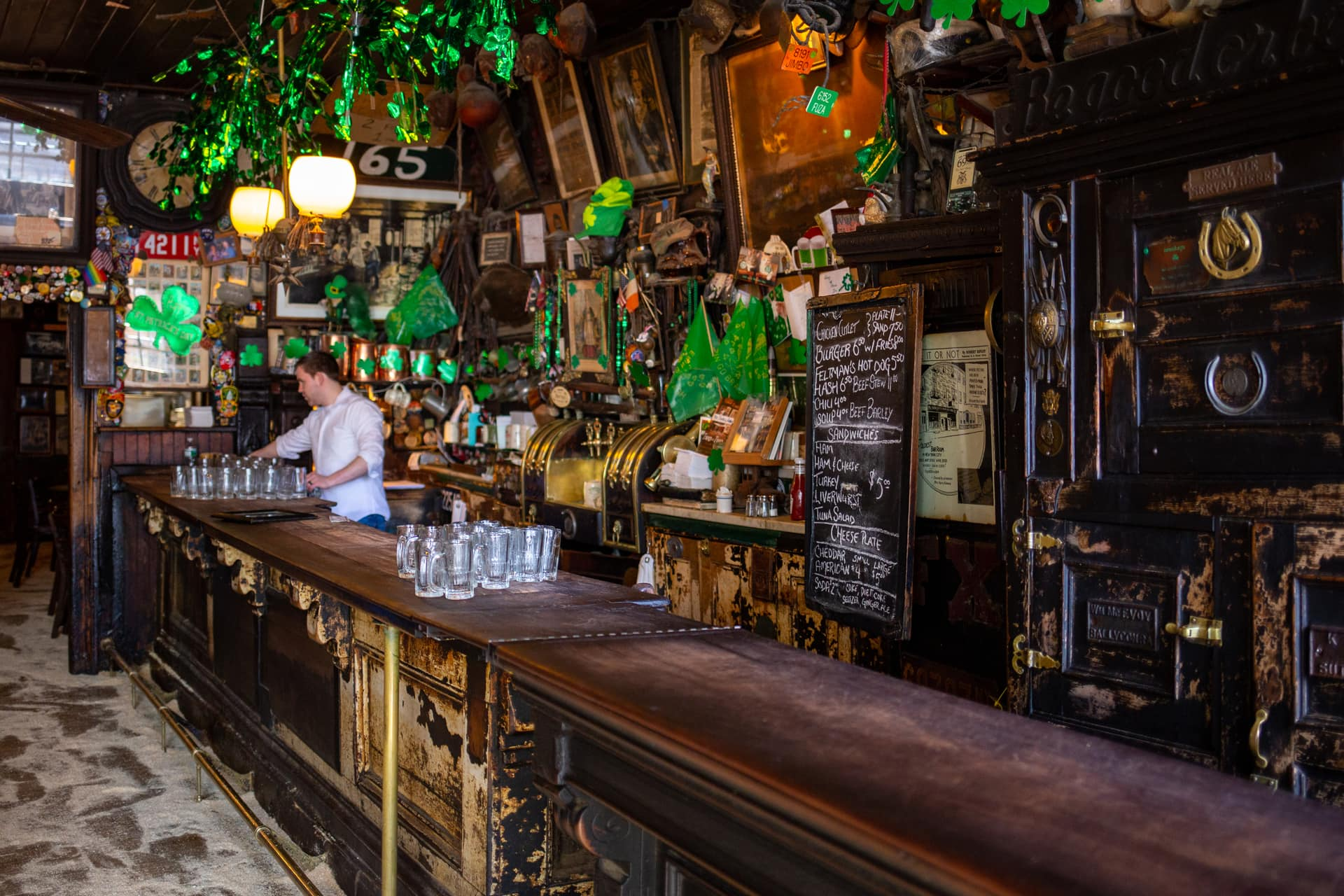 A bartender refills glasses at McSorley's