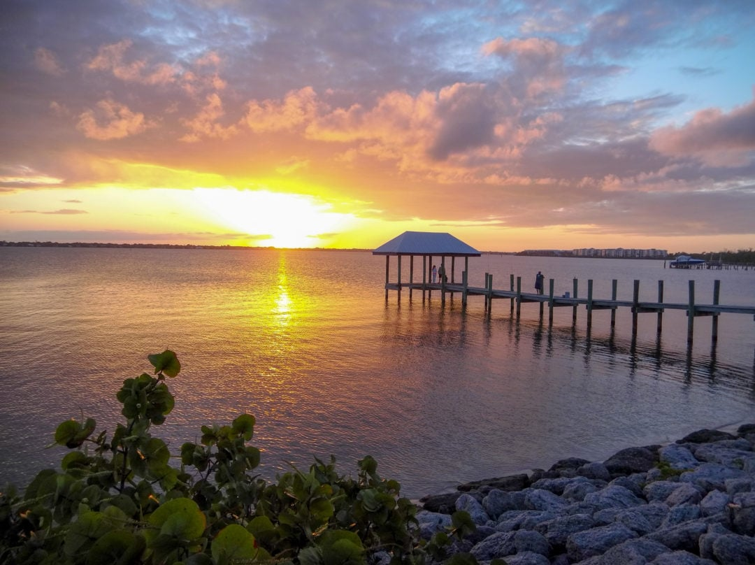 The sun sets on the inlet across from the House of Refuge at Gilbert's Bar in Stuart