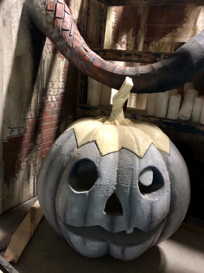 Otherworld's haunted house has Jack-o-lanterns and graves.