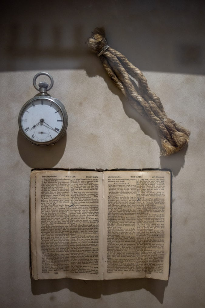A piece of hangman's rope and a Bible.