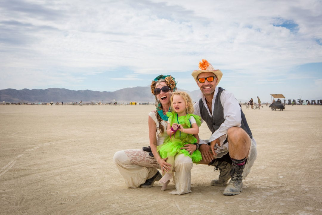 Jesse Gros, Devon Gros (age 2.5), and Alex Zech at Burning Man in 2016.