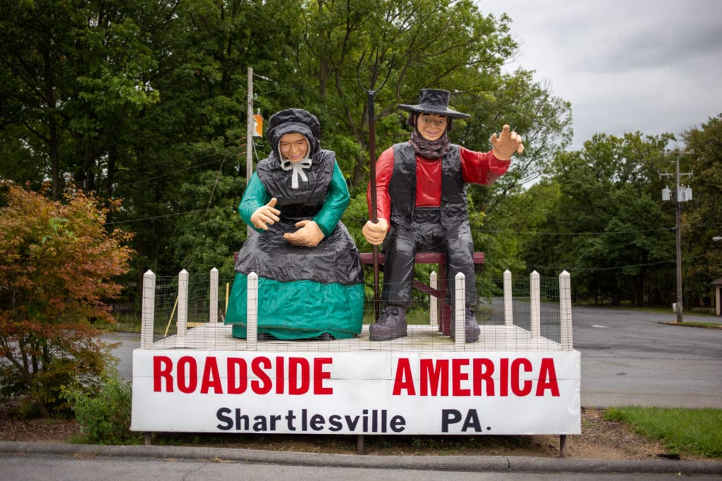 An Amish couple welcomes visitors to Roadside America.