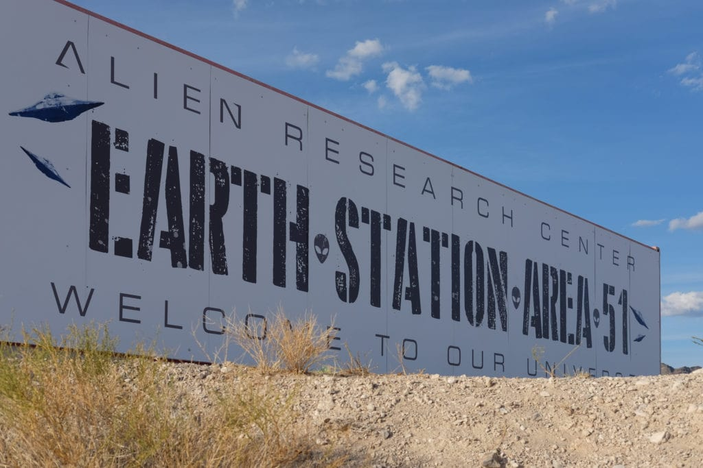 A billboard for the Alien Research Center.