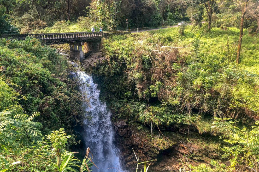 Hikers walk across a bridge on the Road to Hana, one of 59 bridges that exist along the 52-mile roadway.