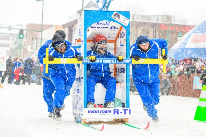 On a roll: At Alaska's annual Outhouse Races, there's no shame in being number two