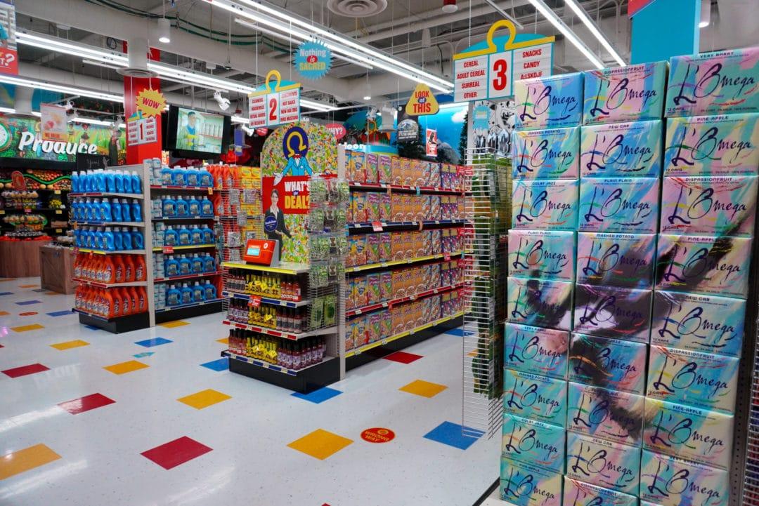 Aisles of groceries inside Omega Mart