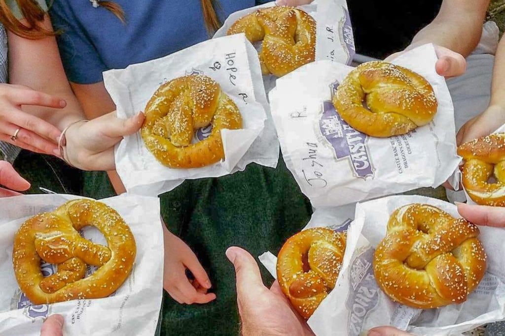 hands hold soft salted pretzels